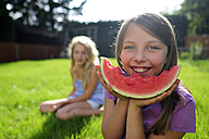 Happy girl with a water melon in garden - ECPF00031