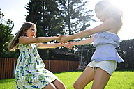Two happy playful girls in garden - ECPF00034