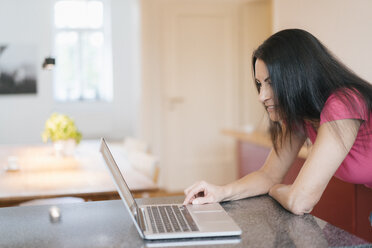 Woman using laptop at home - JOSF01283