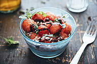 Watermelon salad with eschalot, mint, olive oil and balsamico in bowl - IPF00408