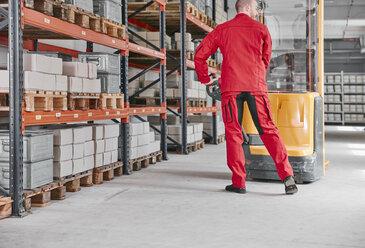 Man in factory using forklift - RHF02023