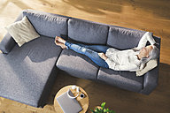 Senior woman relaxing on couch - SBOF00480