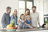 Happy family with grandparents and children standing in the kitchen - SBOF00510