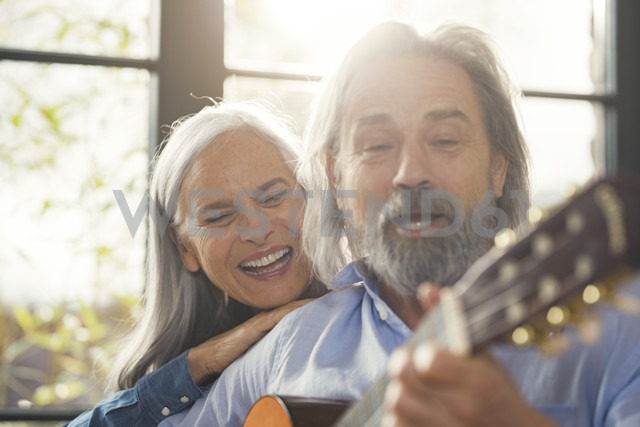 Senior playing guitar and singing loud for his wife - SBOF00549