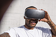 Man wearing Virtual Reality Glasses taking selfie - MGIF00072