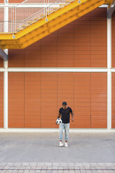 Young man playing with soccer ball - MGIF00090