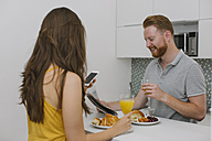 Couple having breakfast in the kitchen - MOMF00209
