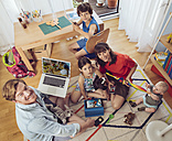 Portrait of happy family in children's room - MFF03722