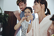 Family of four brushing their teeth - MFF03731