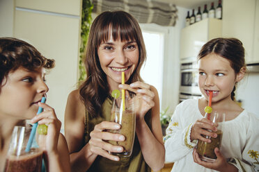 Mother and children enjoying their homemade smoothies - MFF03764