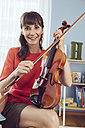 Portrait of a woman with violin in children's room - MFF03794