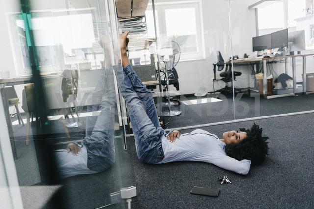 Young woman having a break in office - KNSF02260