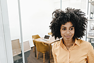 Portrait of young woman in office - KNSF02290