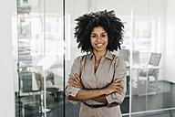 Portrait of confident businesswoman in office - KNSF02317