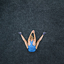 Young woman doing gymnastics, top view - STSF01280