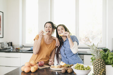 Mother and adult daughter having fun together in the kitchen - JOSF01312