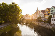 Germany, Tuebingen, view to the city with Neckar River in the foreground at evening twilight - WDF04084