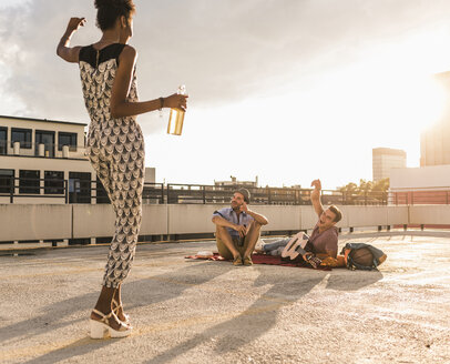 Young woman dancing on a rooftop party - UUF11482