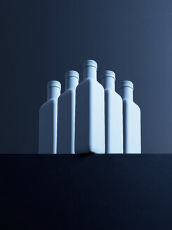 Five bottles in front of dark background, 3D-Rendering - DRBF00023
