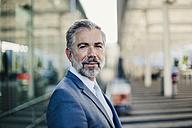 Portrait of confident businessman outdoors - DIGF02618