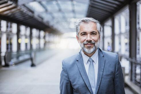 Portrait of confident businessman - DIGF02633
