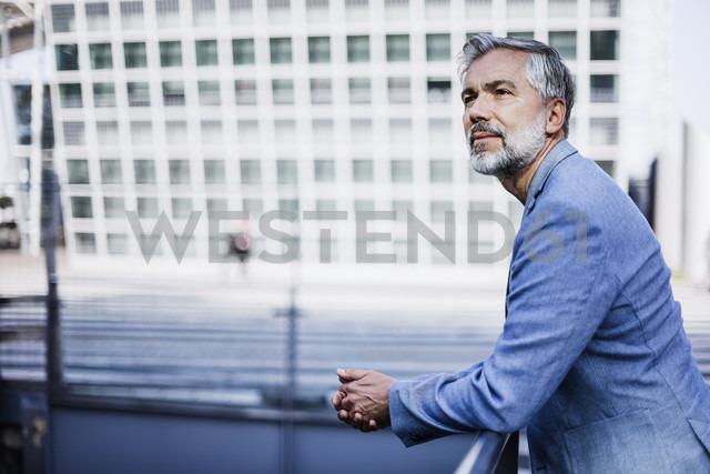 Portrait of confident businessman outdoors - DIGF02636
