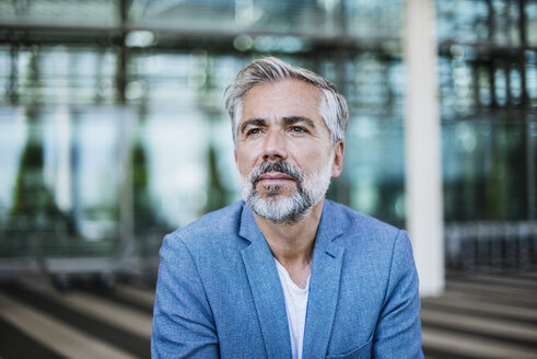 Portrait of confident businessman outdoors - DIGF02642