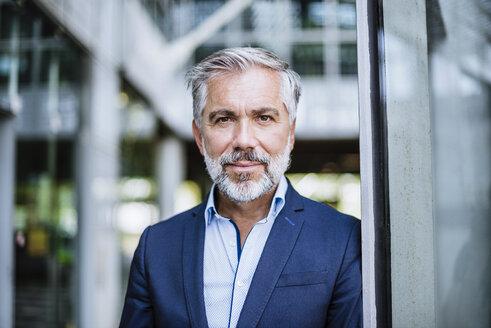 Portrait of confident businessman - DIGF02663