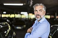 Portrait of businessman in parking garage - DIGF02672