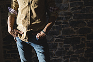 Man with hands in his pockets, partial view - MRAF00209