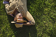 Young man sleeping on a meadow, top view - MRAF00215