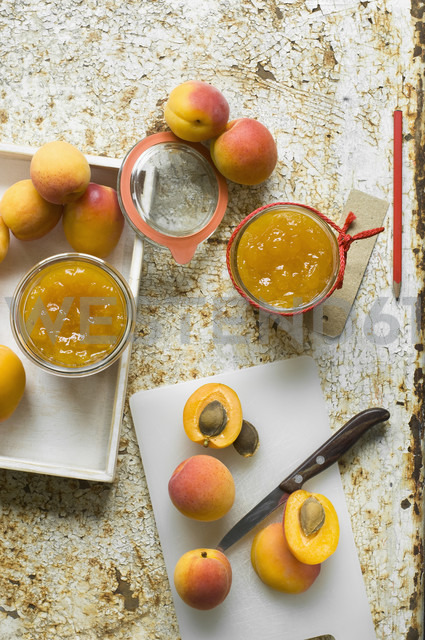 Two glasses of homemade apricot jam and apricots - ASF06102