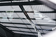 Businessman behind car window - KNSF02374
