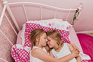 Two little sisters resting on bed - NMSF00139