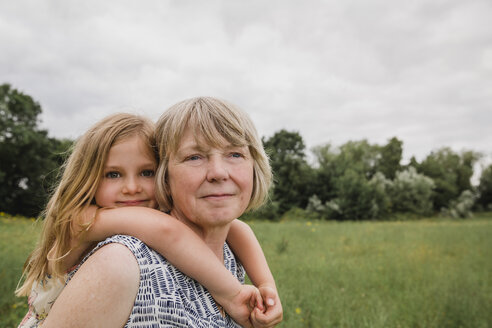 Grandmother giving granddaughter a piggyback ride - NMSF00151