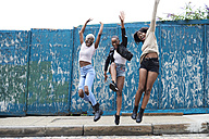 Three friends jumping in the air - IGGF00104