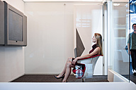Businesswoman having a video conference in a cubicle - ZEF14312