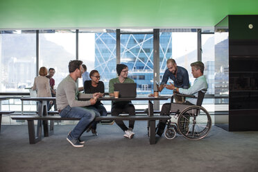 Group of people having a meeting in modern office - ZEF14318