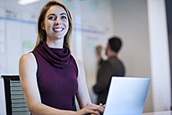 Young woman working in office with a colleague - ZEF14360