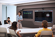 Business people having a meeting in a futuristic office - ZEF14399