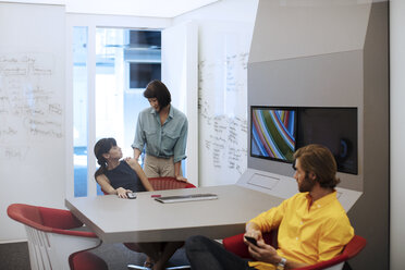 Business people having a meeting in a futuristic office - ZEF14402