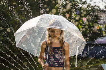 Portrait of daydreaming girl with umbrella - SARF03351