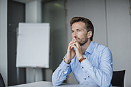 Portrait of pensive businessman in the office - DIGF02713