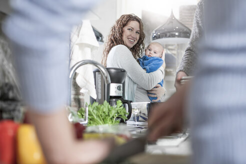 Mother and baby in kitchen while cooking - ZEF14416