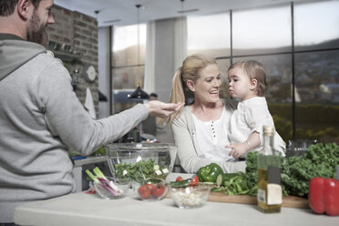 Family with baby preparing a healthy meal in kitchen - ZEF14455