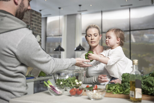 Family with baby preparing a healthy meal in kitchen - ZEF14467