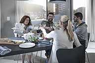 Family and friends having dinner together raising their wine glasses - ZEF14470