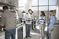 Family and friends with baby and coffee in kitchen - ZEF14476