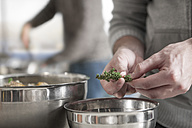 Close-up of man preparing meal in kitchen - ZEF14482