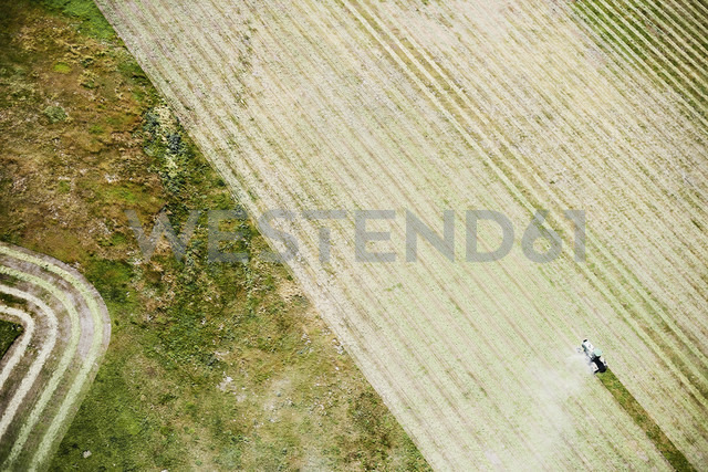 USA, Contour farming with tractor in Eastern Colorado - BCDF00300